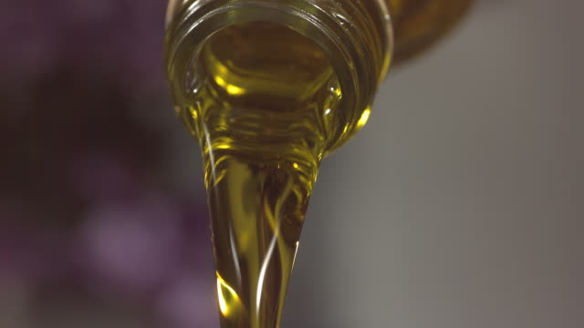 high speed oil pouring from bottle - bottle stock videos & royalty-free footage