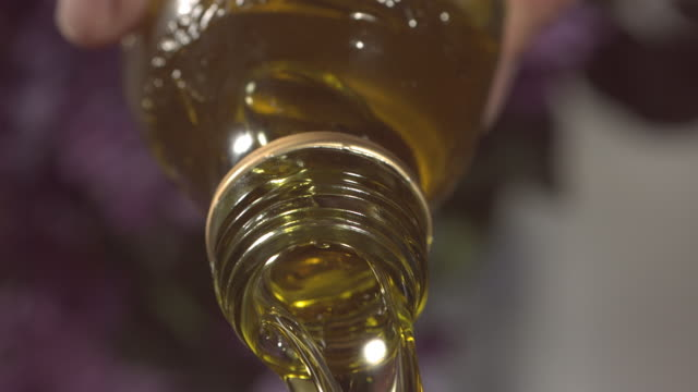 high speed oil pouring from bottle - fried stock videos and b-roll footage