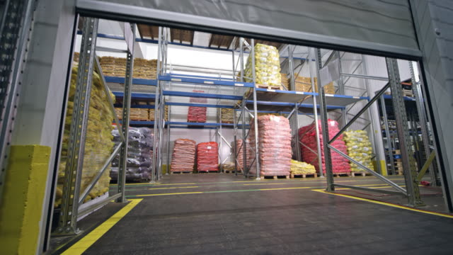 high speed pvc rolling doors in a warehouse - pvc stock videos and b-roll footage