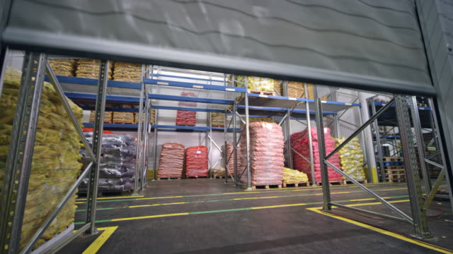 cs high speed pvc rolling doors opening in a warehouse - pvc stock videos and b-roll footage