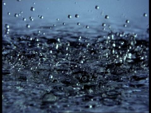 high speed - rain falling onto water - splashing droplet stock videos & royalty-free footage