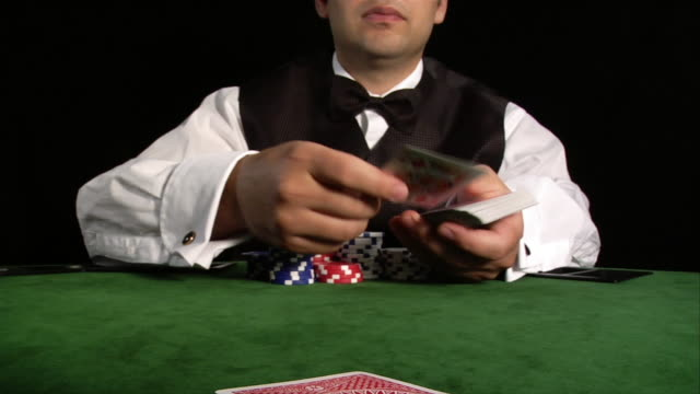 high speed shot of croupier dealing cards at camera - casino worker stock videos and b-roll footage