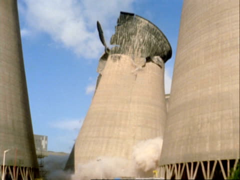 high speed single cooling tower demolition, rugeley power station, staffordshire, uk - demolished stock videos & royalty-free footage