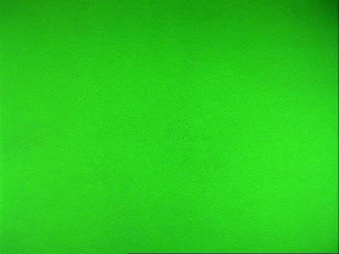 high speed sport - cu tennis racket hits wet tennis ball creating spray, green background - tennis ball stock videos & royalty-free footage