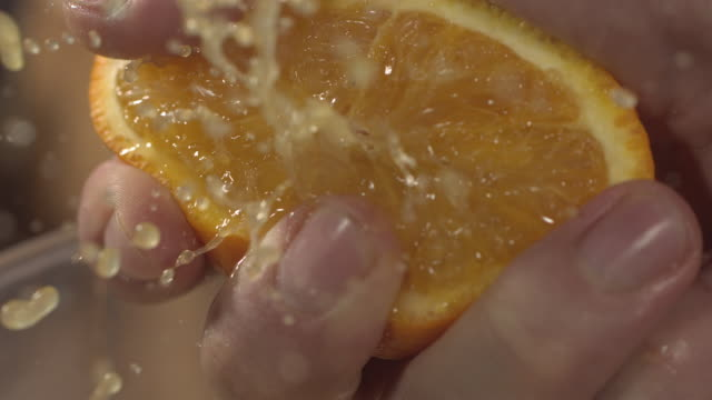 high speed squeezing orange - citrus fruit stock videos and b-roll footage