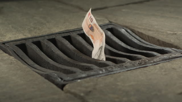 high speed ten pound note falling through drain cover - finance stock videos & royalty-free footage