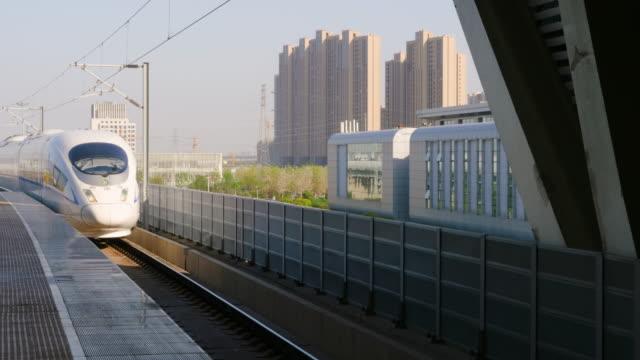 ws ms high speed train arriving at suzhou north station, suzhou, jiangsu province, china - jiangsu province stock videos & royalty-free footage