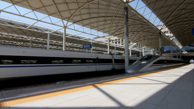 high speed train leaving shijiazhuang city, china - high speed train stock videos & royalty-free footage