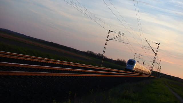 high speed train passing by at dusk - moving past stock videos & royalty-free footage