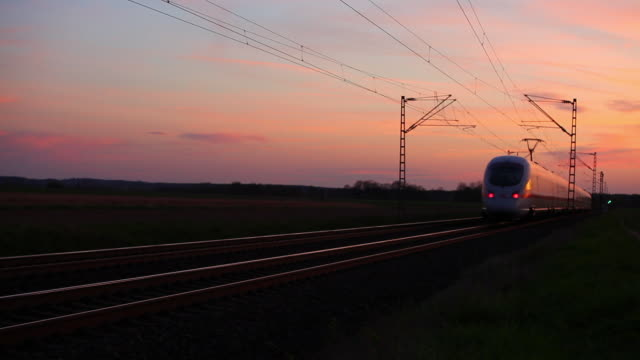 High speed train passing by at dusk