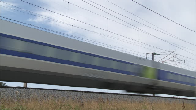 A high speed train races through the French countryside.