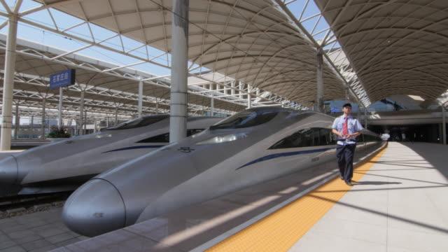 vídeos y material grabado en eventos de stock de high speed train station in shijiazhuang city, china - shirt and tie