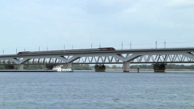 stockvideo's en b-roll-footage met high speed train train (thalys) on the new moerdijk bridge. - kees van den burg