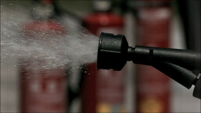 cu high speed water fire extinguisher  nozzle - spraying stock videos and b-roll footage