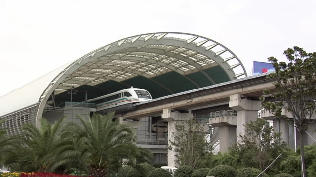ws high speed zaglev train leaving longyang road station/ beijing, china - high speed train stock videos & royalty-free footage