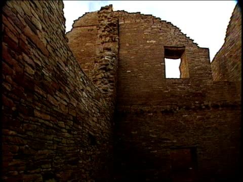 high stone walls form the ruins of pueblo bonito. - pueblo bonito stock videos & royalty-free footage