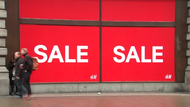 high street and general views of marks and spencer store england london oxford street ext shoppers along / 'sale' sign in hm shop window / general... - finance and economy stock videos & royalty-free footage