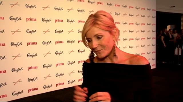 celebrity interviews michelle collins posing for photographs michelle collins interview sot wearing dress by gail berry and shoes from river island /... - michelle collins actress stock videos & royalty-free footage