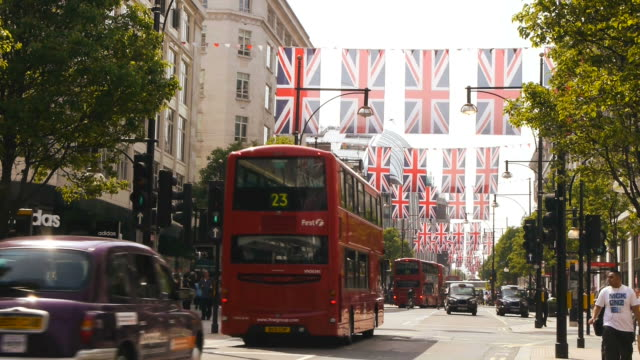high street in london with union jacks - union jack stock videos & royalty-free footage