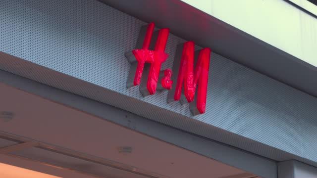 UK High Street shopping Chrismas shopping retailers HM Hennes Mauritz AB UK shop front logo branding