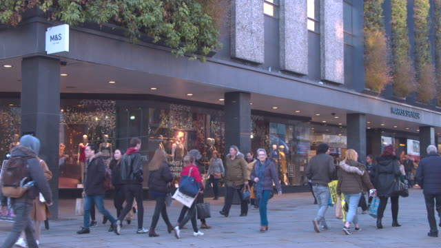 high street shopping, chrismas shopping retailers, marks and spencer uk retailer shop front high street christmas - finance and economy stock videos & royalty-free footage