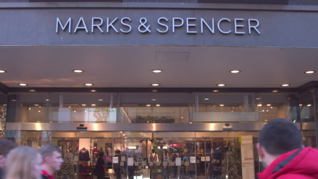 uk high street shopping chrismas shopping retailers marks and spencer uk retailer shop front high street christmas - finance and economy stock videos & royalty-free footage
