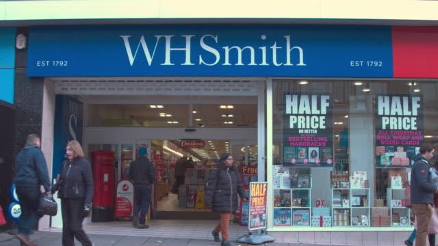 uk high street shopping chrismas shopping retailers whsmith wh smith high street stationary books retailer - magazine stock videos & royalty-free footage