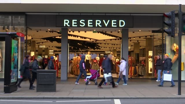 High Street shops need to be more environmentally aware ENGLAND London Oxford Street EXT Shoppers along People passing 'Reserved' store People along...