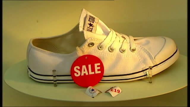 high street spending rises despite credit crunch ext discount signs in shop window as shoppers walk past in f/g shoes on display with 'sale' signs in... - discount shop stock videos & royalty-free footage
