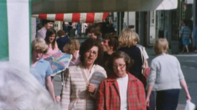 1981 montage high street traffic, pedestrians, and shoppers, emphasizing the wide range of goods imported from western europe / united kingdom - collection stock videos & royalty-free footage