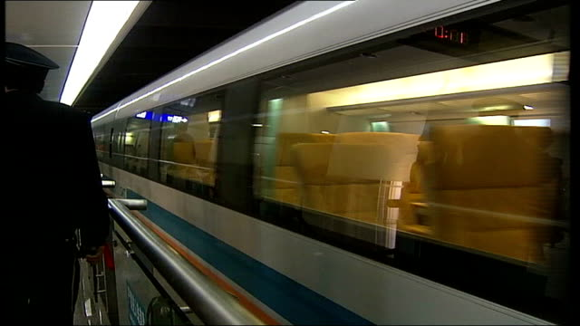 high tech train crashes on test run file / tx shanghai airport int maglev magnetic levitation train pulls into platform view from window as train... - levitation stock videos and b-roll footage