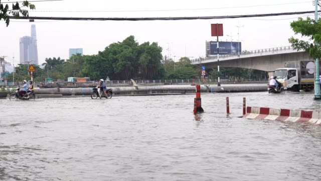 high tide in ho chi minh city. - embankment stock videos & royalty-free footage