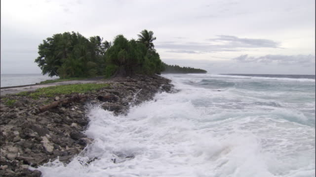 high tide washes onto low lying island, funafuti atoll, tuvalu - pacific islands stock videos & royalty-free footage