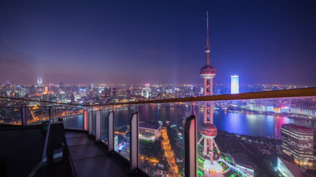 high up rooftop view of shanghai landmark oriental pearl tower and huangpu river nightscape transition - river huangpu stock videos & royalty-free footage