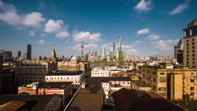 high up rooftop view of shanghai urban cityscape and lujiazui financial center daytime transition - 屋根点の映像素材/bロール