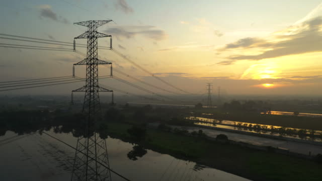 high up view electricity pylons in the sunrise - power cable stock videos & royalty-free footage