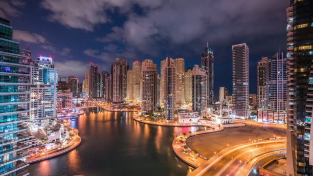 high up view of dubai futuristic cityscape night to day transition - bay of water stock videos & royalty-free footage