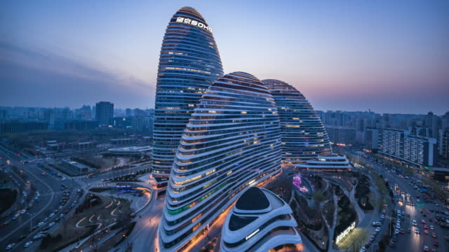 high up view of modern city architecture dusk to night transition - beijing stock videos & royalty-free footage