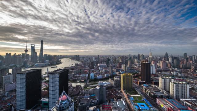 high up view of modern city daytime transition - 東方明珠塔点の映像素材/bロール