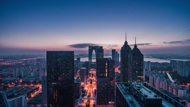 high up view of modern city night to day transition - 東方明珠塔点の映像素材/bロール