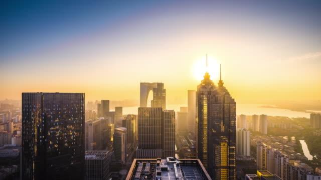 high up view of modern city sunrise transition - 東方明珠塔点の映像素材/bロール