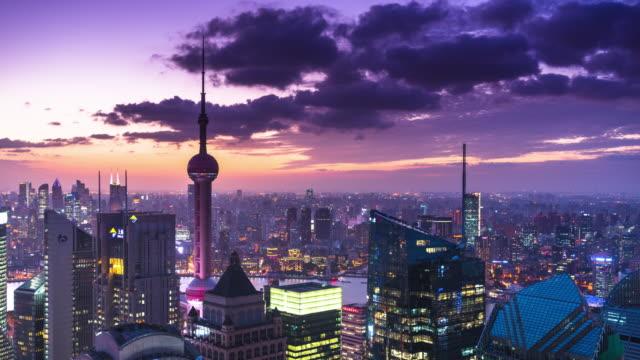 high up view of shanghai financial center twilight to night transition - 東方明珠塔点の映像素材/bロール