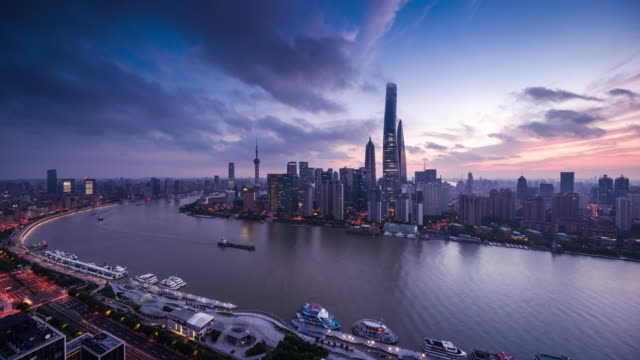 high up view of shanghai huangpu river and city center dawn to day transition - 東方明珠塔点の映像素材/bロール