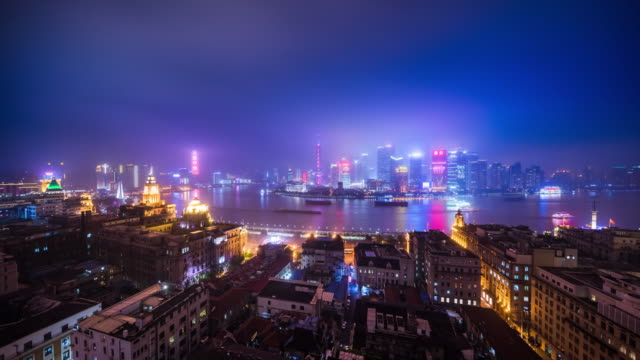 high up view of shanghai huangpu riverside nightcape transition - 東方明珠塔点の映像素材/bロール