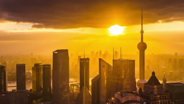 high up view of shanghai lujiazui cityscape and oriental pearl tower sunrise transition - 東方明珠塔点の映像素材/bロール