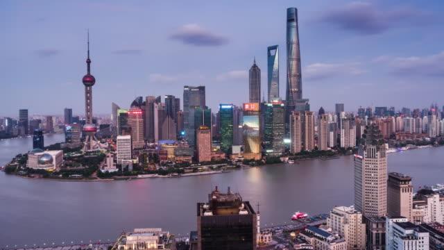 high up view of shanghai lujiazui financial center dusk to night transition - 東方明珠塔点の映像素材/bロール
