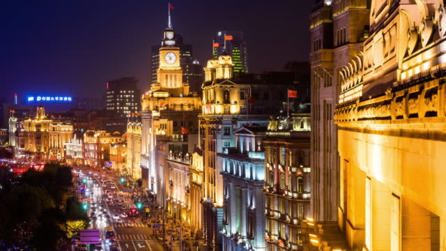 high up view of shanghai the bund old architecture and urban road night transition - 東方明珠塔点の映像素材/bロール