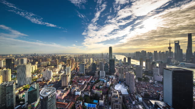 high up view of shanghai urban city skyline daytime transition - 東方明珠塔点の映像素材/bロール