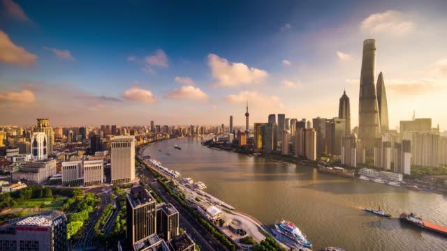 high up view of shanghai urban cityscape and huangpu riverside daytime transition - 東方明珠塔点の映像素材/bロール