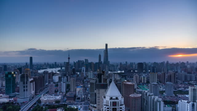 high up view of shanghai urban cityscape cloudy day transition - 東方明珠塔点の映像素材/bロール